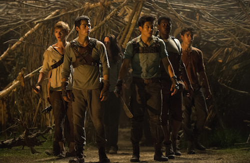THE MAZE RUNNER (From left) Newt (Thomas Brodie-Sangster), Thomas (Dylan O'Brien), Teresa (Kaya Scoderlario), Minho (Ki Hong Lee), Frypan (Dexter Darden), and Winston (Alex Flores) react to a shocking development in the Glade. Photo Credit: Ben Rothstein TM and © 2014 Twentieth Century Fox Film Corporation. All Rights Reserved. Not for sale or duplication.