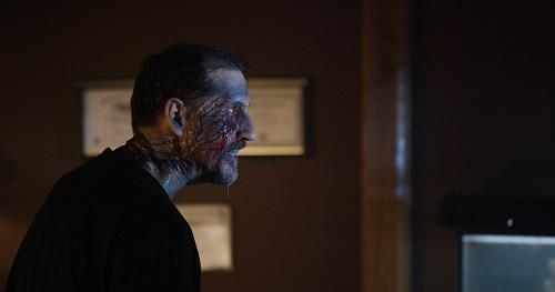 John Speredakos as Dr. Michael Slovak in the horror film THE MIND'S EYE, an RLJ Entertainment release. Photo credit Joe Begos.