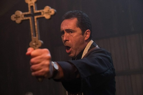 DEMIAN BICHIR as Father Burke in New Line Cinema's horror film THE NUN, a Warner Bros. Pictures release. Photo by Justin Lubin.