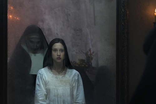 (L-R) BONNIE AARONS as The Nun and TAISSA FARMIGA as Sister Irene in New Line Cinema's horror film THE NUN, a Warner Bros. Pictures release. Photo by Cos Aelenei.
