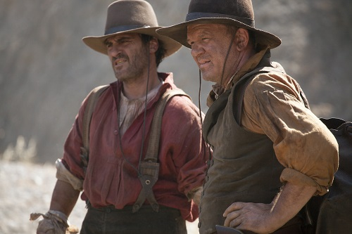 Joaquin Phoenix (left) stars as Charlie Sisters and John C. Reilly (right) stars as Eli Sisters in Jacques Audiard's THE SISTERS BROTHERS, an Annapurna Pictures release. Credit : Magali Bragard / Annapurna Pictures.