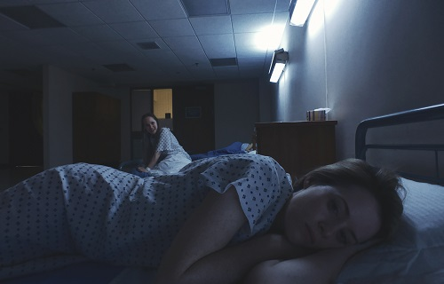 Juno Temple (left) stars as Violet and Claire Foy (right) stars as Sawyer Valentini in Steven Soderbergh's UNSANE, a Fingerprint Releasing and Bleecker Street release. Credit: Fingerprint Releasing / Bleecker Street.