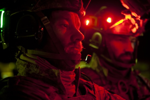 Flying a stealth blackhawk helicopter, Joel Edgerton (left), and his brother Nash Edgerton, play the SEAL Team Six soldiers raiding Osama Bin Laden's compound in Columbia Pictures' mesmerizing new action thriller from director Kathryn Bigelow, ZERO DARK THIRTY. PHOTO BY: Jonathan Olley COPYRIGHT: © 2012 Columbia Pictures Industries, Inc. All rights reserved.