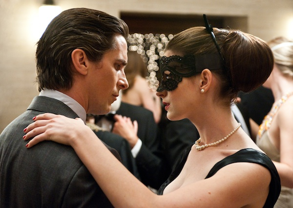 CHRISTIAN BALE as Bruce Wayne and ANNE HATHAWAY as Selina Kyle in Warner Bros. Pictures' action thriller