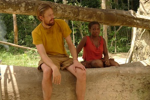 """Larry Whitman"" (Kris Marshall) with ""Makombe"" (Mbombi), the chief's granddaughter"