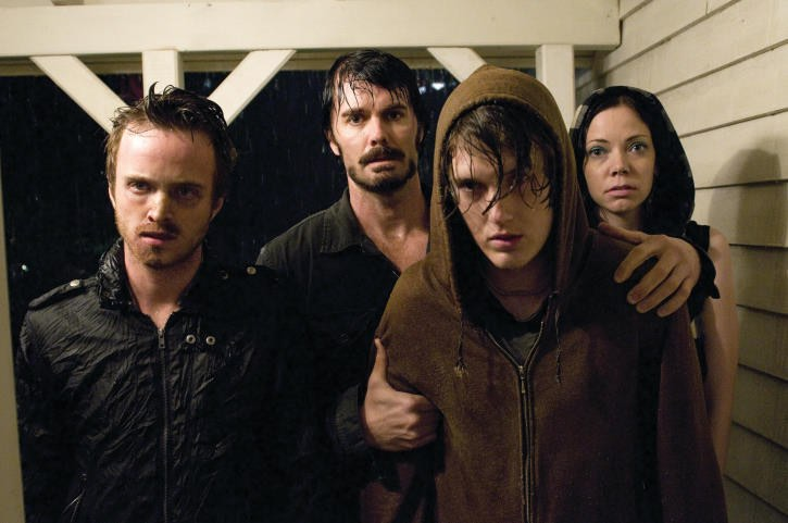 (L to R) Francis (AARON PAUL), Krug (GARRET DILLAHUNT), Justin (SPENCER TREAT CLARK) and Sadie (RIKI LINDHOME) knock on the Collingswood in The Last House on the Left