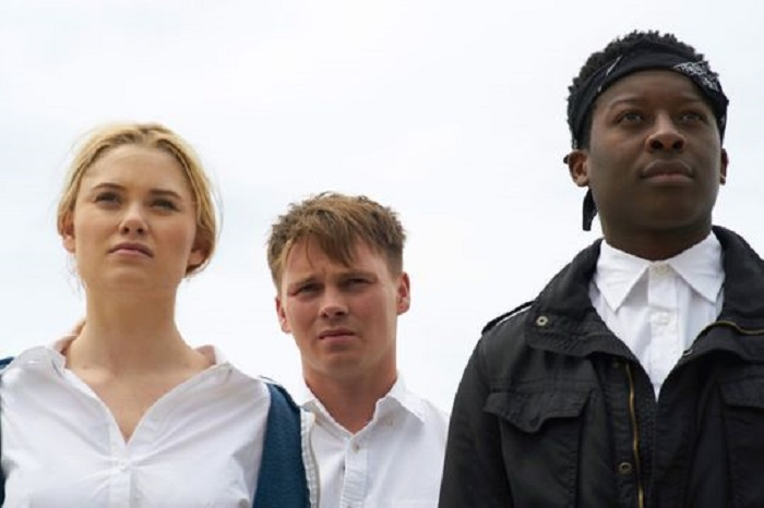 Virginia Gardner, Sam Strike, and Brandon Micheal Hall in Monster Party, image courtesy RLJE Films.