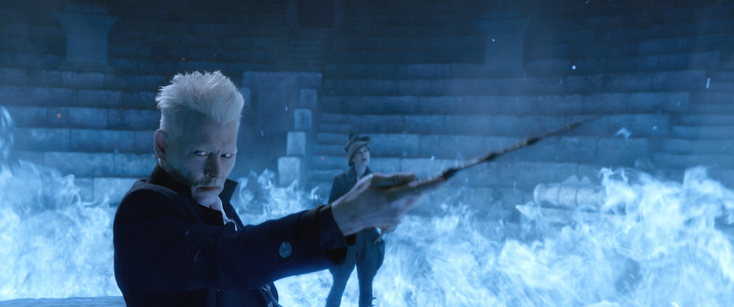 (L-R) JOHNNY DEPP as Grindelwald and POPPY CORBY-TUECH as Rosier in Warner Bros. Pictures' fantasy adventure 'Fantastic Beasts: The Crimes of Grindelwald,' a Warner Bros. Pictures release. © 2018 WARNER BROS. ENTERTAINMENT INC.