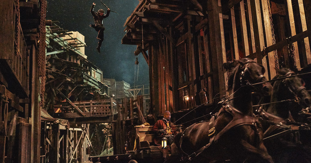 Robin (Taron Egerton, left) and John (Jamie Foxx, right) in Robin Hood. Photo credit: Attila Szvacsek.