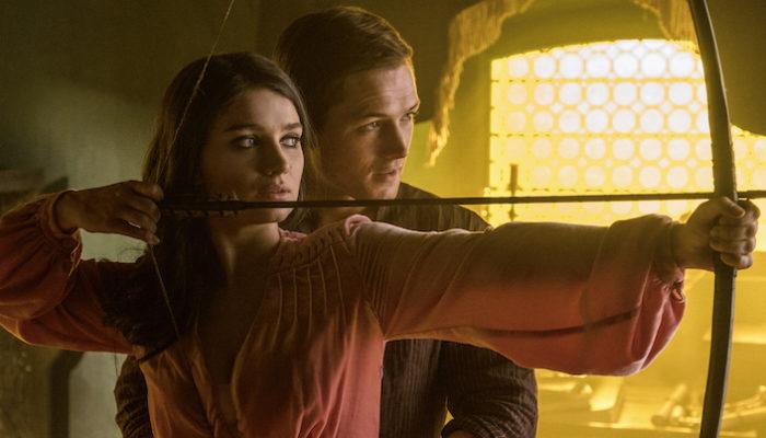 Marian (Eve Hewson) and Robin (Taron Egerton) in Robin Hood. Photo Credit: Attila Szvacsek.