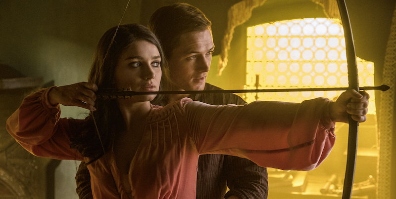 Marian (Eve Hewson) and Robin (Taron Egerton) in Robin Hood. Photo Credit: Attila Szvacsek.