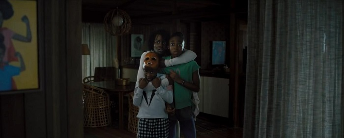 Evan Alex, Lupita Nyong'o, and Shahadi Wright Joseph in Us, courtesy Monkeypaw Productions/Universal Pictures.