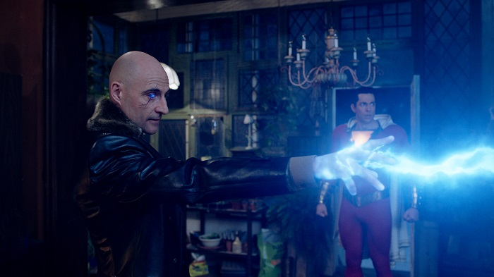 "(l-r) MARK STRONG as Dr. Thaddeus Sivana and ZACHARY LEVI as Shazam in New Line Cinema's action adventure ""SHAZAM!,"" a Warner Bros. Pictures release. Photo Courtesy of Warner Bros. Pictures."