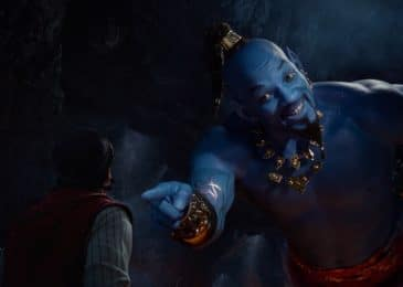 Aladdin (Mena Massoud) meets the larger-than-life blue Genie (Will Smith) in Disney's live-action adaptation ALADDIN, directed by Guy Ritchie
